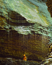 Woman Walking Beneath Cliff Ov...