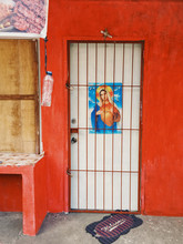 Picture Of Mother Mary On House Door