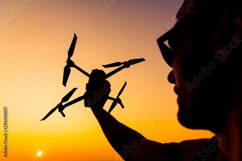 Obraz na plátně  Men Flying Small Drone
