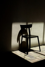Empty Chair Near Wall