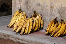 Bunches Of Bananas Kept On Wall