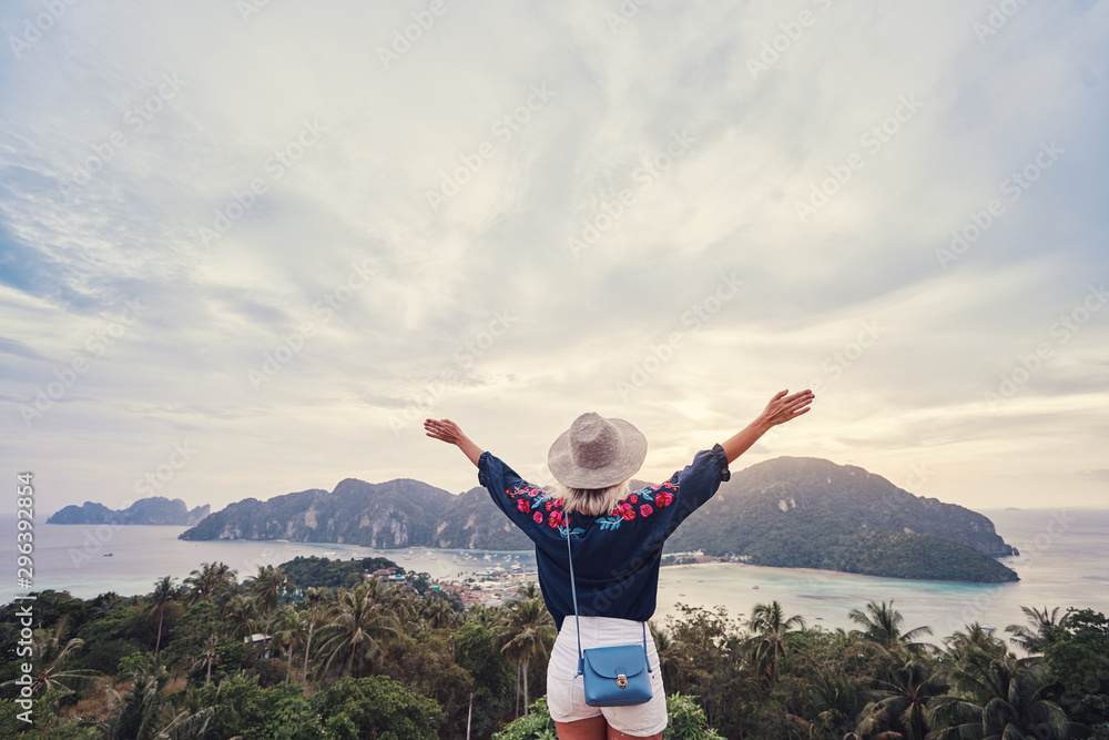 Fototapety, obrazy: Traveling by Thailand. Young woman enjoying wonderful sunset on Phi Phi Don island view. point.