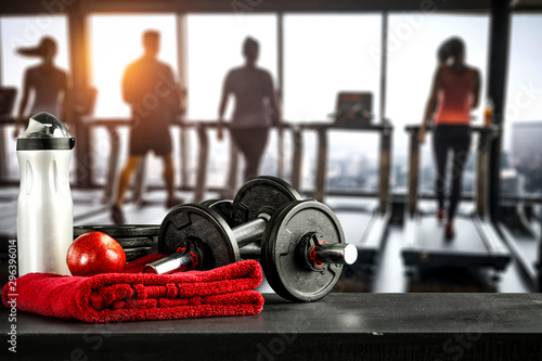 Poster Fitness Dumbbells in gym interior and free space for your decoration.