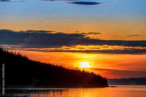 Silhouette Mountain on Coast at Sunset