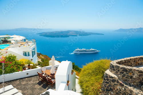 Obraz White architecture and blue sea on Santorini island, Greece. Summer holidays, travel destinations concept - fototapety do salonu