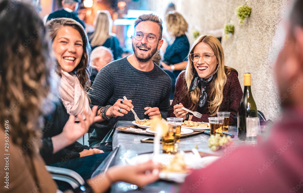 Fototapety, obrazy: Young friends having fun drinking white wine at street food festival - Happy people eating local plates at open air restaurant together - Travel and dinning lifestyle concept on bulb light neon filter