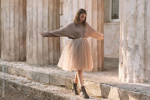 Teen girl in brown tulle skirt and autumn sweater Fototapeta