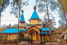 A Beautiful Wooden Russian Church With Blue Roof In Michurinskoye (Saint-Petersburg)