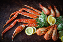 Crab Legs On Brown Rustic Back...