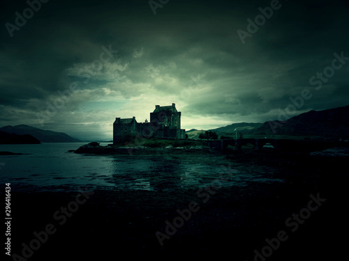 haunted mystic eerie Eilean Donan Castle in Scotland with the sea around it and Wallpaper Mural
