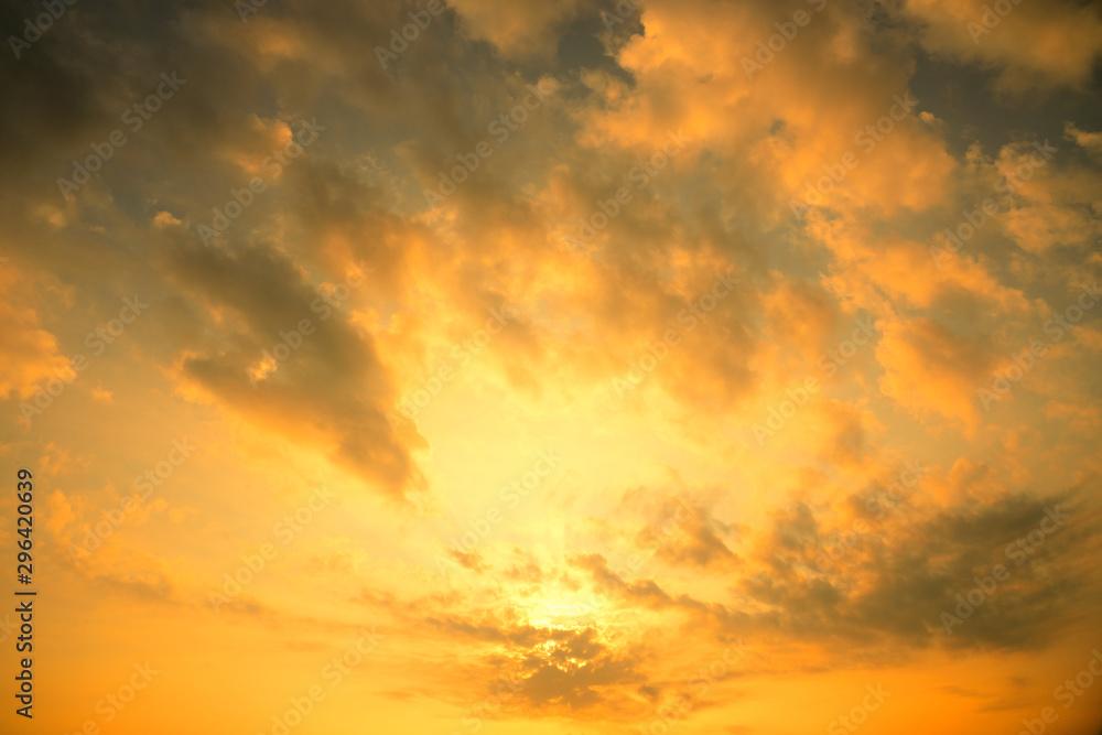 Fototapety, obrazy: Golden sun light with dark cloud before sunset.