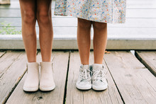 Two Little Girls Legs And Booties