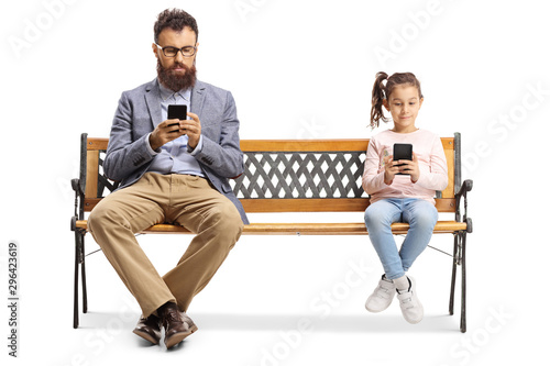 Father and daughter sitting on a bench with mobile phones Wallpaper Mural