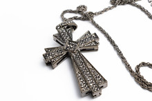 Big Cross With Rhinestones On A White Background Isolate