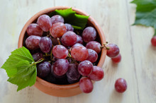 Beautiful Red Grapes Are In The Bowl.