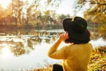 Traveler Relaxing By Autumn Ri...