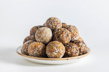 Homemade Energy Balls With Dried Apricots, Raisins, Dates, Prunes, Walnuts, Almonds And Coconut. Healthy Sweet Food. Energy Balls In A Plate On A White Background