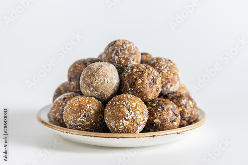 Photo Homemade energy balls with dried apricots, raisins, dates, prunes, walnuts, almonds and coconut