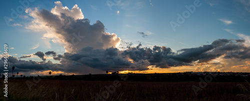 sunset over bebedouro city sith giants clouds Wallpaper Mural