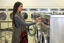 Woman In A Self-service Laundry