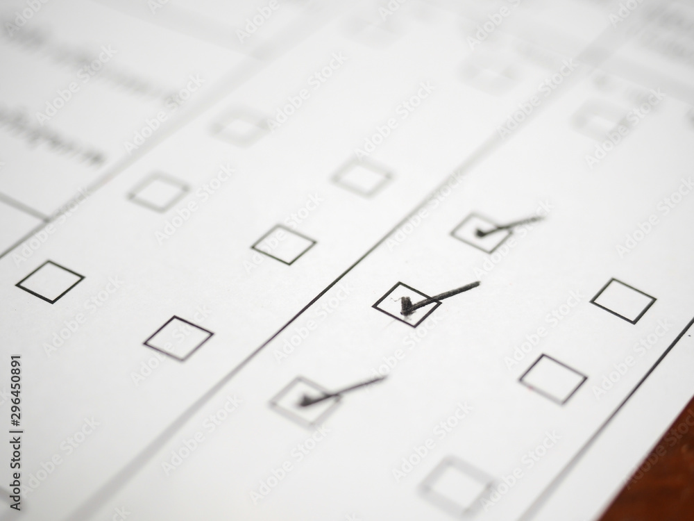 Fototapety, obrazy: Black marking on checklist box,clos up.Checklist concept