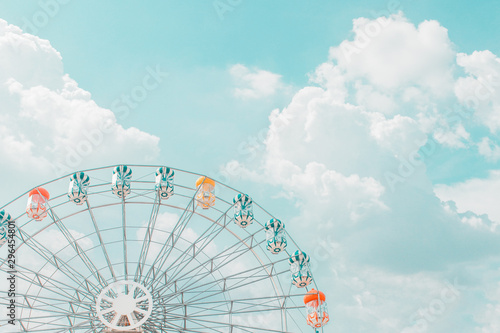 Retro pastel colorful ferris wheel of the amusement park in the blue sky  and cloud background Slika na platnu