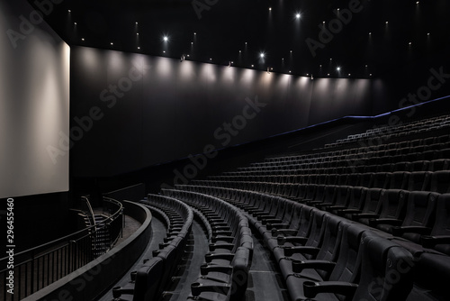 Photo Black cinema white wide screen and auditorium seats