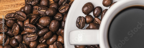 Keuken foto achterwand Cafe A cup of coffee and scattered coffee beans. Layout. Flat lay. Coffee bean.
