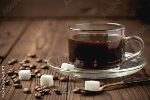Canvas Prints Cafe black coffee cup on wooden table.