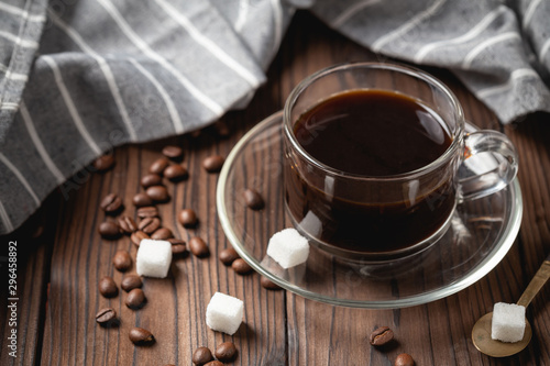 Keuken foto achterwand Cafe black coffee cup on wooden table.