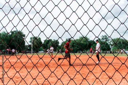 Fotografia, Obraz Picture of the softball field being played  That was taken through the net