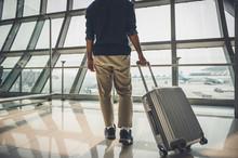 A Male Traveler Wearing A Gray...