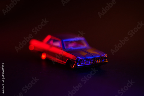 Toy car under red and blue lights