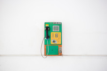 Coin-operated Public Payphone And White Background