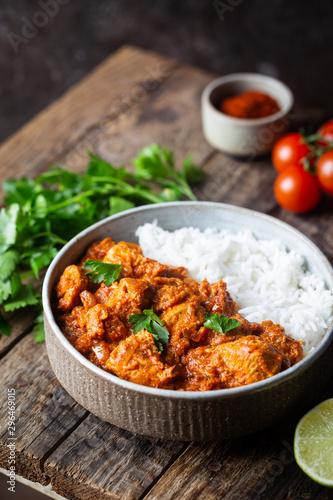 Obraz Chicken meat with tikka masala sauce, spicy curry food in a bowl with rice and seasonings - fototapety do salonu