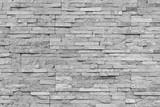 Fototapeta Kamienie - White natural facade stone decoration quartzite background texture. modern granite stone wall.
