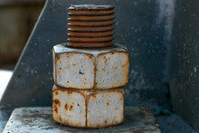 A Large Rusted Bolt With Screw...