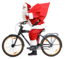 Santa Claus With Bag And Bicycle On White Background