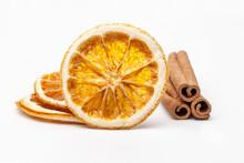 Dried Orange And Cinnamon Sticks On White Background.