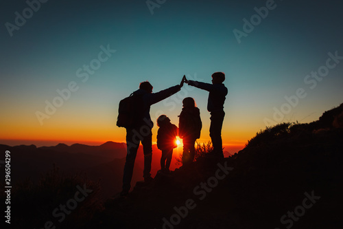 family with kids travel in sunset mountains, parenting concept