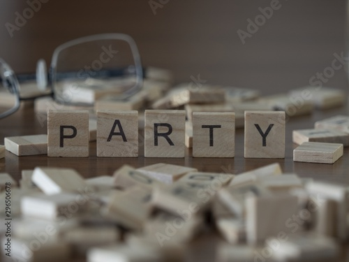 Obraz na plátně  The concept of Party represented by wooden letter tiles