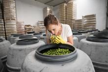 Worker Woman Smelling Olives I...