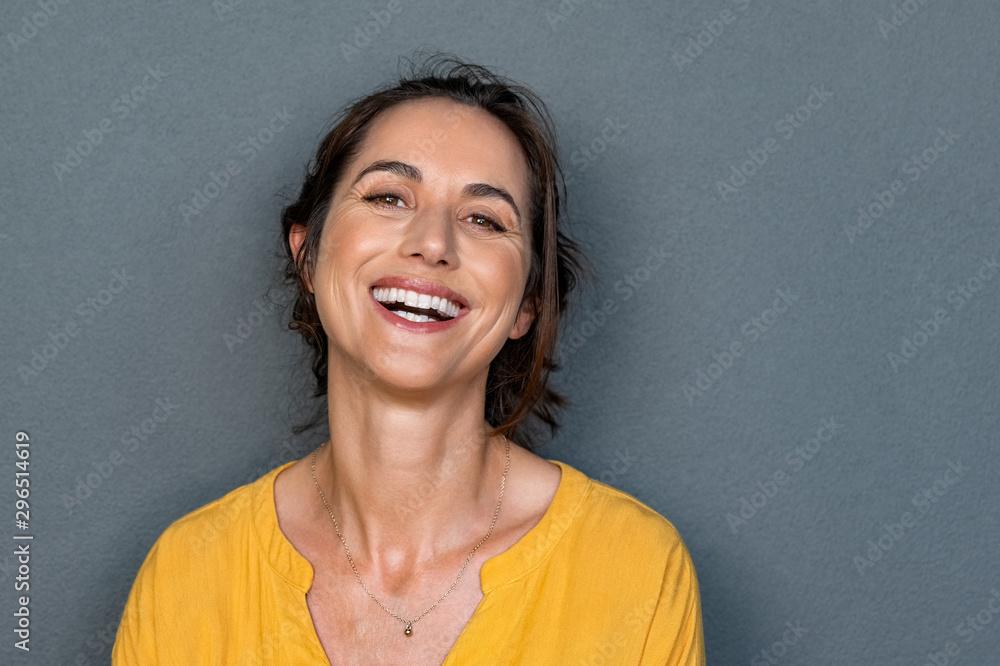 Fototapeta Cheerful mature woman smiling