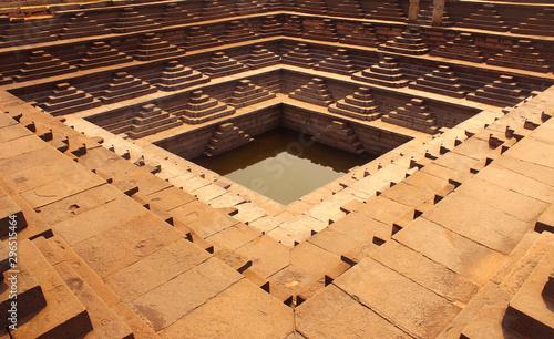 Fotografie, Obraz  The famous ancient Stepped Tank in Hampi