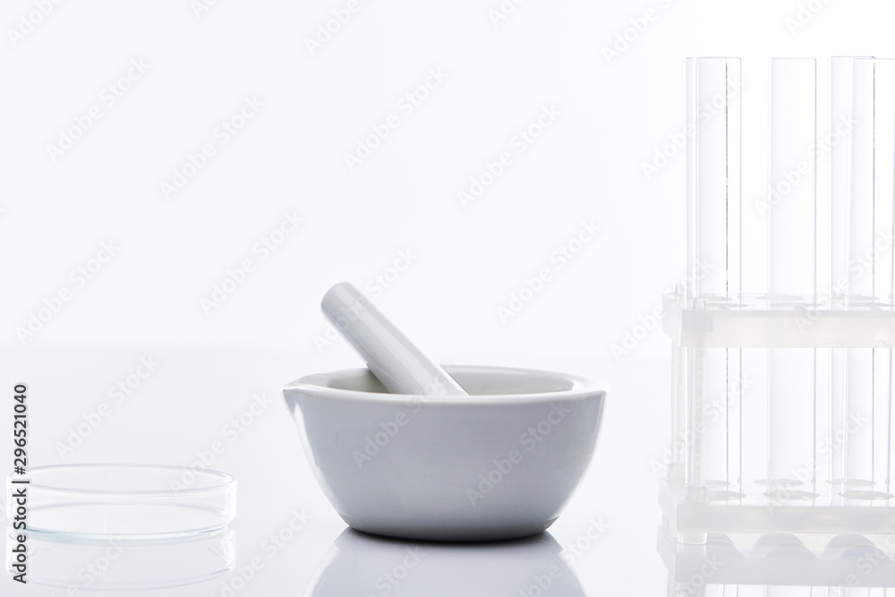 Fototapety, obrazy: empty glass test tubes and mortar with pestle isolated on white