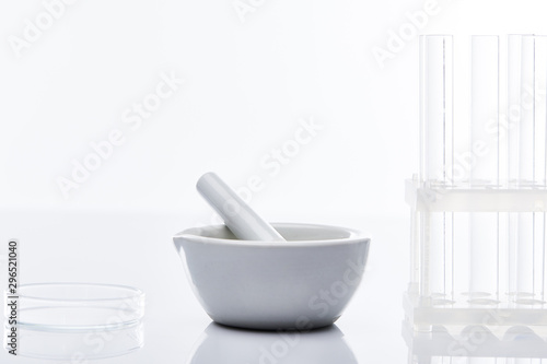 empty glass test tubes and mortar with pestle isolated on white Canvas Print