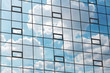 canvas print picture - Multiple windows background with sky reflection. View of double glazed windows with sky reflection. Symmetry and texture. Windows background. Facade of a modern glass fronted building
