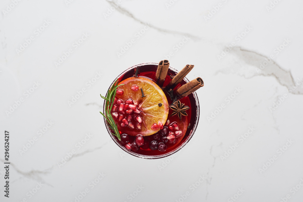 Fototapeta top view of christmas cocktail with orange, pomegranate, cinnamon
