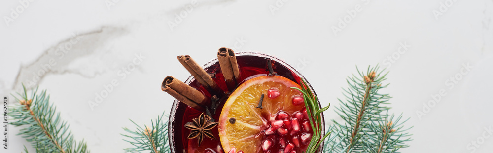 Fototapeta panoramic shot of christmas cocktail with orange, pomegranate, cinnamon