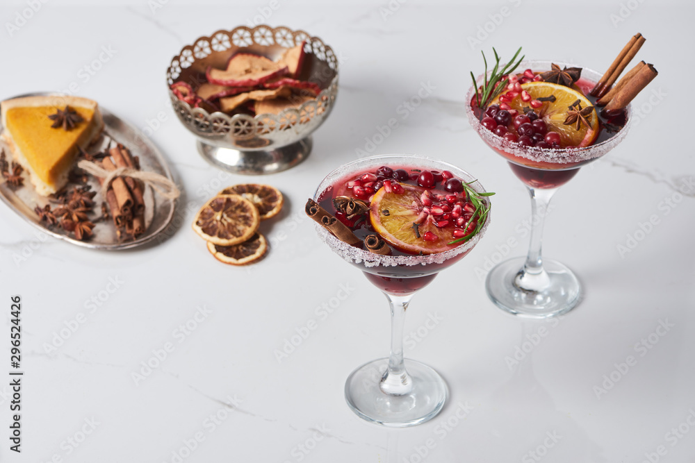 Fototapeta christmas cocktails with orange, pomegranate, cinnamon, apple pie and dry apples